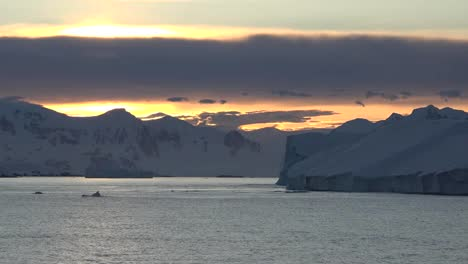 Antarctica-Sunrise-Zooms-And-Pans-From-Iceberg