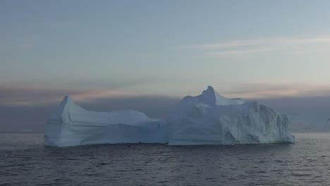 Antarctica-Sunrise-Zooms-To-Iceberg