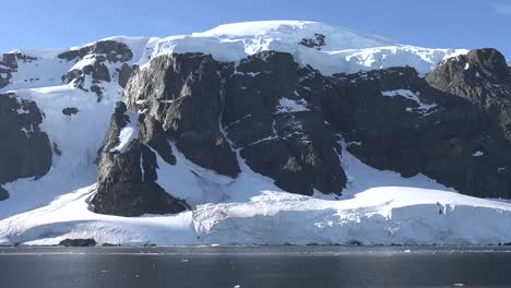 Antarctica-Zooms-Out-From-Black-Cliff