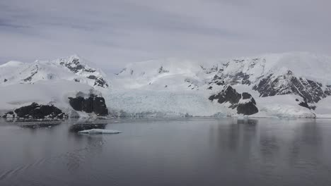 Antarctica-Zooms-Out-From-Black-Rocks-And-Glacier