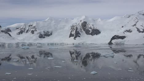Antarctica-Zooms-To-Floating-Ice-And-Reflections