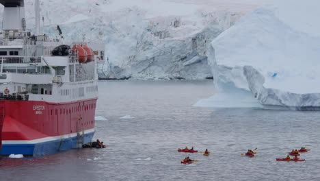 Antarctica-Zooms-To-Kayaks-Behind-An-Expedition-Ship