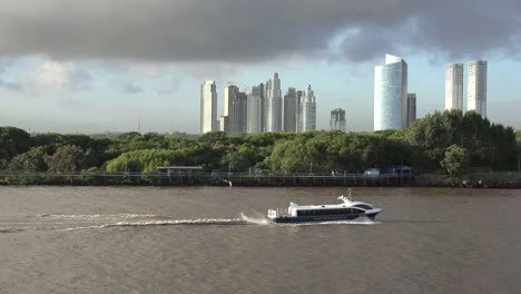 Argentina-Buenos-Aires-Boat-Passes-Skyscrapers