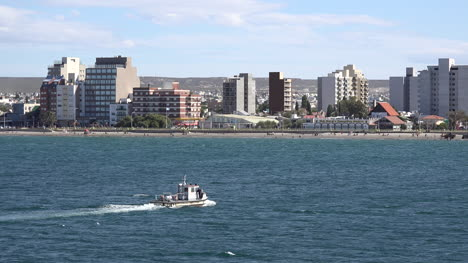 Argentina-Puerto-Madryn-Boat-Passes-By-Skyline