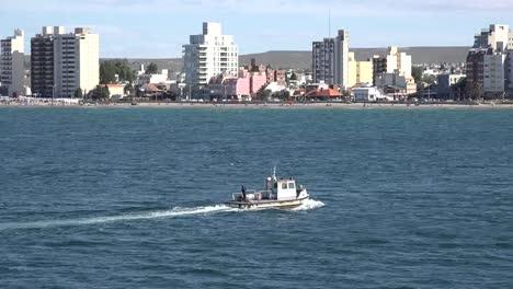 Argentina-Boat-Passes-Puerto-Madryn-Skyline