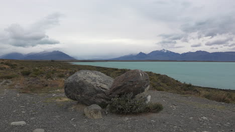 Argentina-Boulders-Frame-View-Of-Lake-Argentino