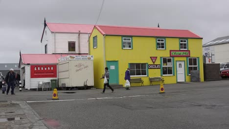 Falklands-Port-Stanley-With-Yellow-Building-And-Tourists