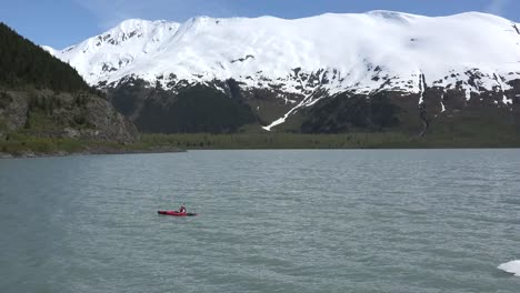 Alaska-Red-Kayak-And-Snowy-Mountain