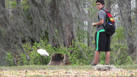 Georgia-Okefenokee-Boy-Turns-And-Walks-Away