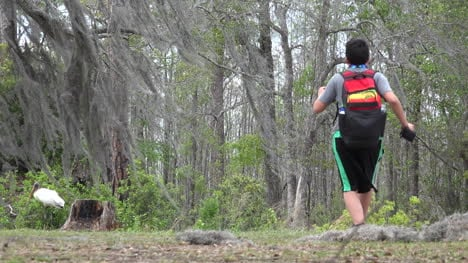Georgia-Okefenokee-Boy-Walks-With-Backpack