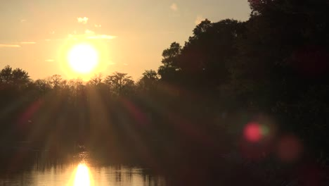 Georgia-Okefenokee-Sunset-Over-Woods-And-Water-Suns-Rays