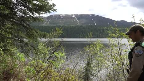 Alaska-Ranger-Walks-By-Lake