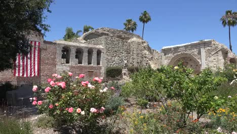 California-San-Juan-Capistrano-Mission-Bell-Wall-With-Flag-And-Roses