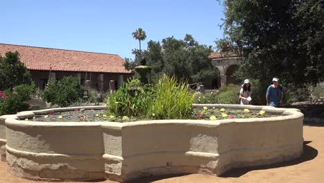 California-San-Juan-Capistrano-Mission-Courtyard-Fountain-Tourists