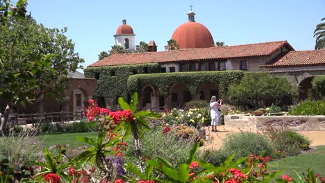 California-San-Juan-Capistrano-Mission-Courtyard-Tourist-Photographing-Fountain