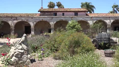 California-San-Juan-Capistrano-Mission-Courtyard-Wagon-Barrels-Colonnade