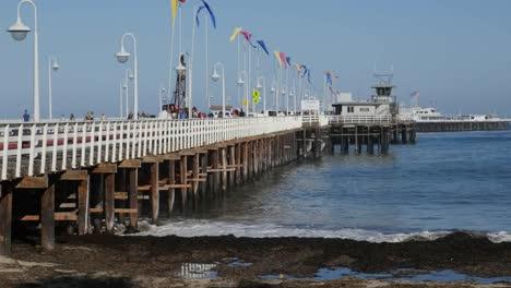 California-Santa-Cruz-Pier-With-Flags-And-Waves