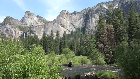 California-Yosemite-River-With-Falls-In-Distance
