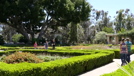 California-Couple-With-Stroller-Walks-Through-Garden