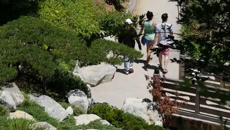 California-People-Walking-Over-A-Bridge-And-Through-A-Garden