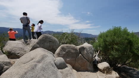 California-Tourist-Family-On-Rocks-At-Yosemite