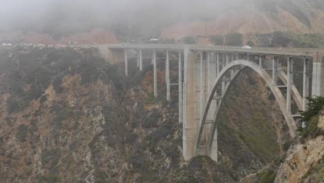 California-Big-Sur-Bixby-Bridge-From-South-With-Cars-And-Fog-Pan