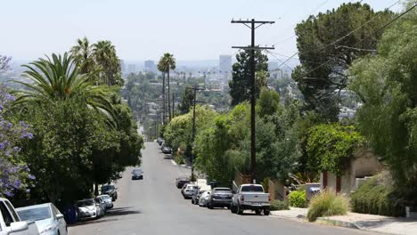 California-Los-Angeles-Car-Driving-Up-Street-On-Hill
