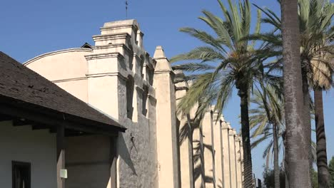 California-Mission-San-Gabriel-Arcangel-Side-View-And-Palm-Zooms-Out