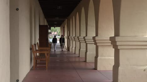 California-Solvang-Mission-Santa-Ines-Colonnade-With-Couple-Zoom-In