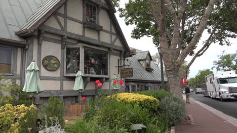 California-Solvang-Half-Timber-Shop-Front-And-Tourist-On-Sidewalk