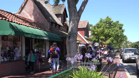 California-Solvang-Sidewalk-And-Flowers-With-Pedestrians