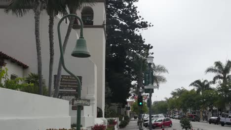 California-Ventura-Mission-San-Buenaventura-With-Camino-Real-Sign-And-Street-Zoom-In