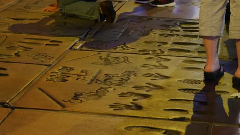 Los-Angeles-Hollywood-Walk-Of-Fame-With-Hand-Prints-In-Concrete-At-Night