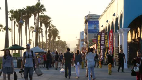 Los-Angeles-Venice-Beach-Boardwalk-Visitors-Walking-Past-Late-Afternoon
