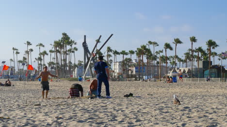 Los-Angeles-Venice-Beach-Girl-Chases-Seagull-And-Cartwheels