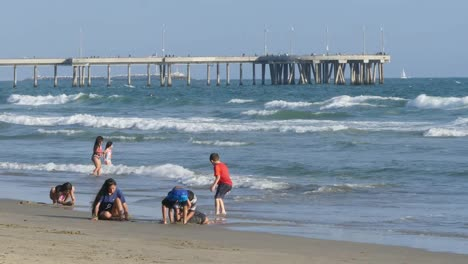 Los-Angeles-Venice-Beach-Girl-Runs-Past-Kids-Playing-In-Surf