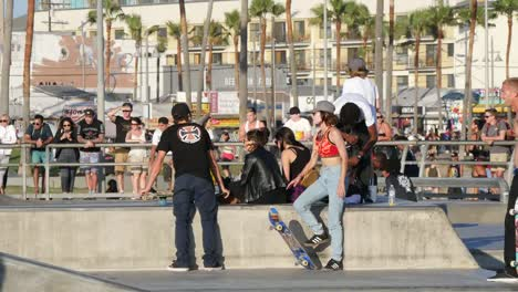 Los-Angeles-Venice-Beach-Skaters-Taking-A-Break-With-Spectators
