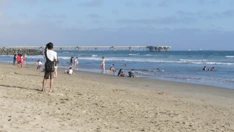 Los-Angeles-Venice-Beach-Visitors-With-Pier-In-Background