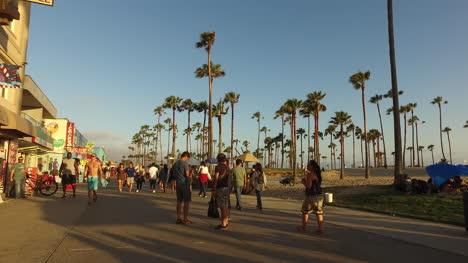 Los-Angeles-Venice-Beach-Walking-Down-Boardwalk-Past-Visitors