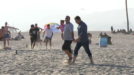 Los-Angeles-Venice-Beach-Young-Men-Playing-Soccer-Against-Bright-Hazy-Sky