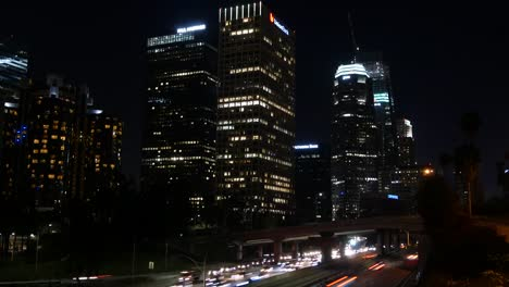 Los-Angeles-Brightly-Lit-Skyscrapers-And-Traffic-At-Night-Time-Lapse