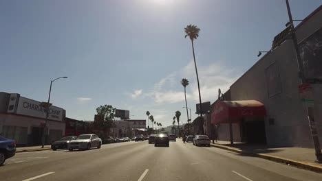 Los-Angeles-Driving-Down-A-Street-Into-The-Sun