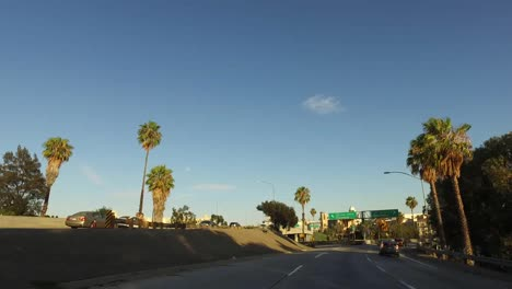 Los-Angeles-Driving-Past-Road-Signs