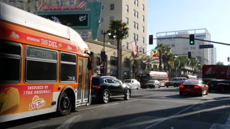 Los-Angeles-Green-Light-And-Busses-On-Hollywood-Boulevard