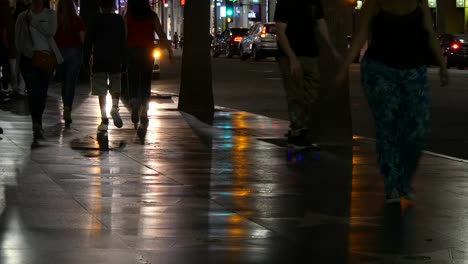 Los-Angeles-Pedestrians-On-Hollywood-Sidewalk-At-Night-With-Skateboarder