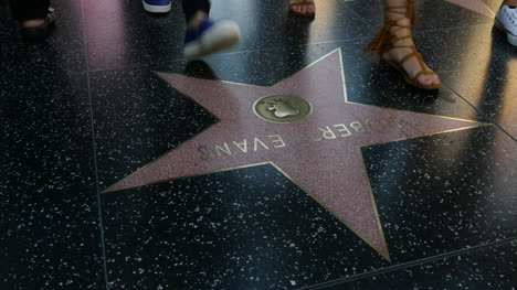Los-Angeles-Tilts-Up-From-Feet-Walking-On-The-Hollywood-Walk-Of-Fame