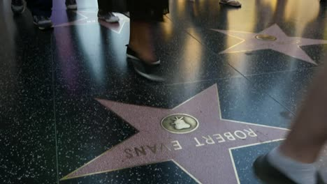 Los-Angeles-Tilts-Up-From-Stars-On-The-Hollywood-Walk-Of-Fame