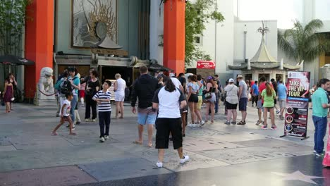Los-Angeles-Tilts-Up-From-Tourists-In-Front-Of-Chinese-Theater