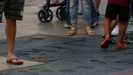 Los-Angeles-Tourists-Walk-On-Concrete-At-The-Hollywood-Walk-Of-Fame