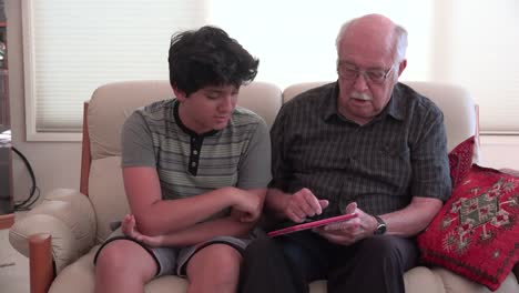 Boy-And-Grandfather-Using-A-Tablet